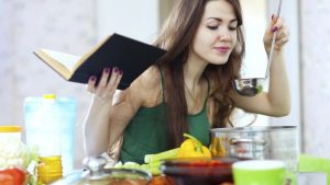 woman preparing potluck with ladle and bible